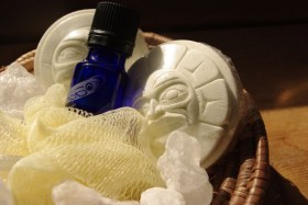 Haida Sun and Moon bath fizzer with rock salts and essential oil mist in antique basket
