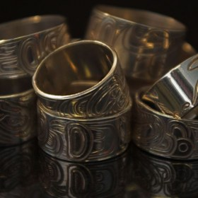 Hand Carved silver half inch rings by North West Coast Native artists