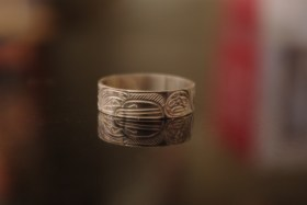 Hand Carved silver ring with Ravens and Moon by Northwest Coast artist William Cook